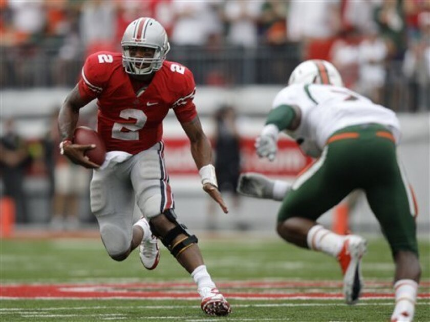 Ohio State quarterback Terrelle Pryor (2) cuts away from Miami defensive back Vaughn Telemaque on a fourth quarter run during an NCAA college football game Saturday, Sept. 11, 2010, in Columbus, Ohio. Pryor ran for 113 yards and a touchdown and passed for 233 yards and a touchdown in Ohio State's 36-24 win. (AP Photo/Jay LaPrete)
