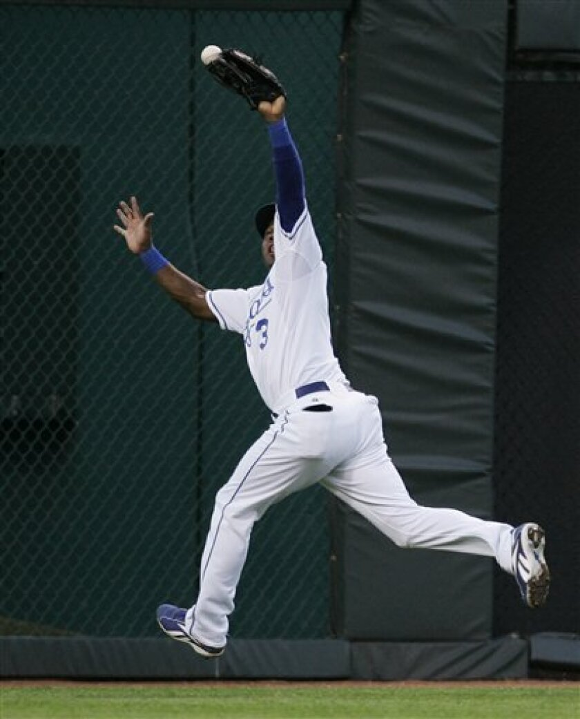 Kansas City Royals outfielder Esteban German fails to catch a fly ball off the bat of Colorado Rockies' Clint Barmes during the fifth inning of a baseball game in Kansas City, Mo., Monday, June 23, 2008. German was charged with an error on the play. Barmes scored later in the inning. (AP Photo/Orlin Wagner)