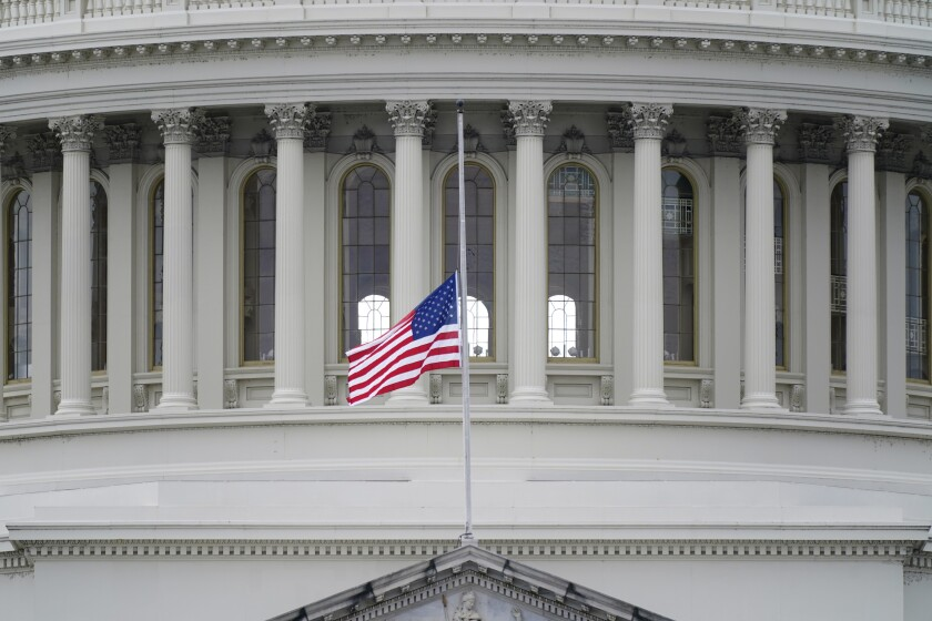 A flag flies at half-staff above the Capitol in honor of Capitol Police Officer Brian Sicknick on Jan. 8, 2021.