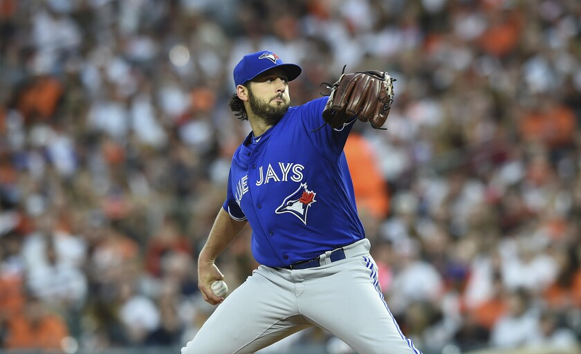 Toronto Blue Jays starting pitcher Mike Bolsinger delivers against the Baltimore Orioles.