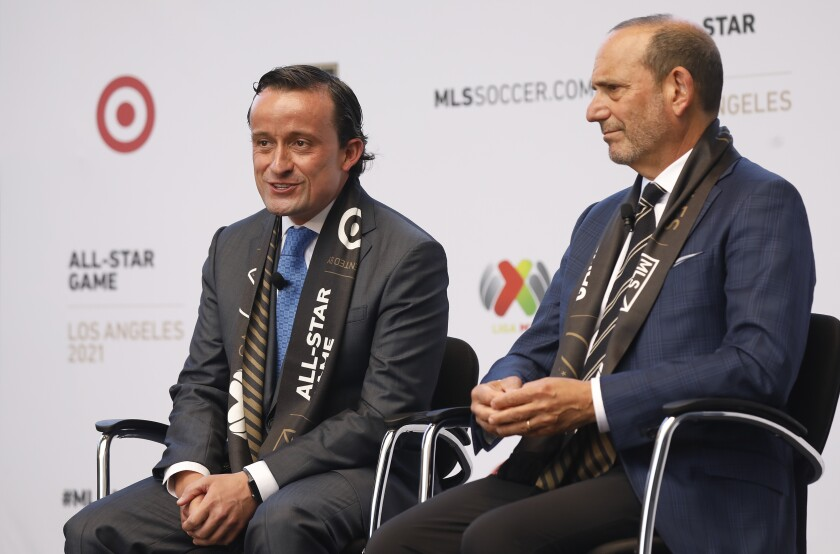 MLS commissioner Don Garber, right, and Liga MX executive president Mikel Arriola, left, speak at a press conference