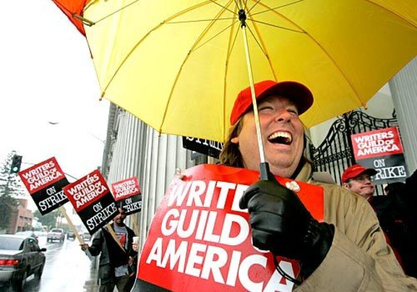 The rain dampened picket lines, if not spirits, as John Matta and compatriots from the Writers Guild of America walked outside Sony Pictures in Culver City on Friday morning.