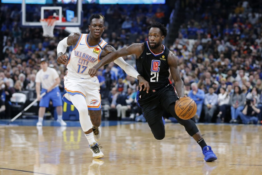 Clippers guard Patrick Beverley drives against Thunder guard Dennis Schroder during the first half of a game March 3.