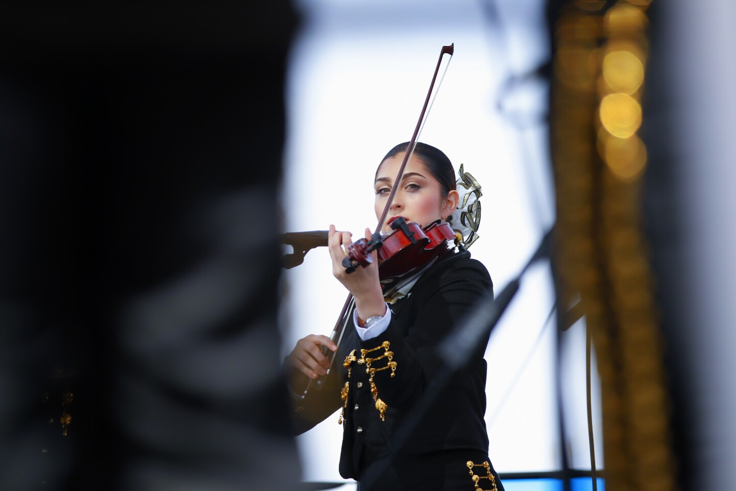 One of the violinist from the Mariachi Estrellas de Chula Vista plays during a solo performance. She and the group were performing on Sunday at the annual International Mariachi Festival in National City.