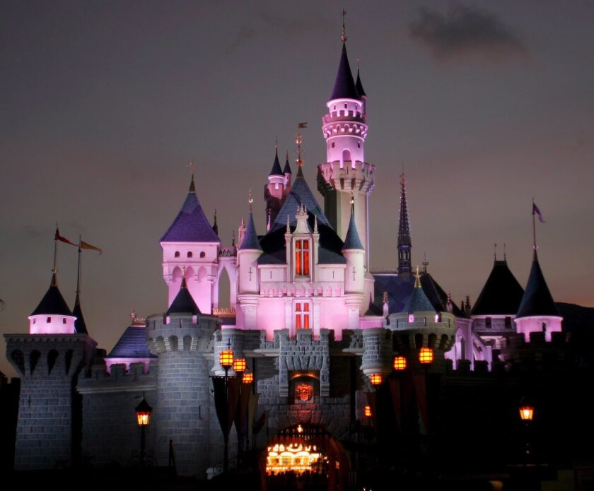 Sleeping Beauty's castle is lit up during the night at Hong Kong Disneyland.
