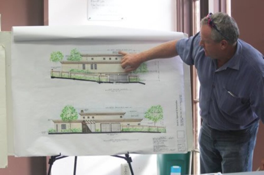 Brian Longmore (representing architect Scott Spencer)  discusses long-stalled plans for 1,282 square feet of ground-level additions to the Lambert Felice residence at 2382 Villa Capri Court.