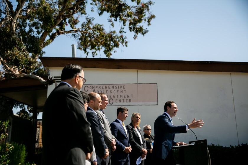 "County Supervisor Nathan Fletcher speaks at a press conference alongside city councilmembers Chris Ward and Jennifer Campbell announcing a proposal to develop a ""Regional Hub for Behavioral Health Continuum of Care"" at a vacant Hillcrest property on Mar. 25, 2019."