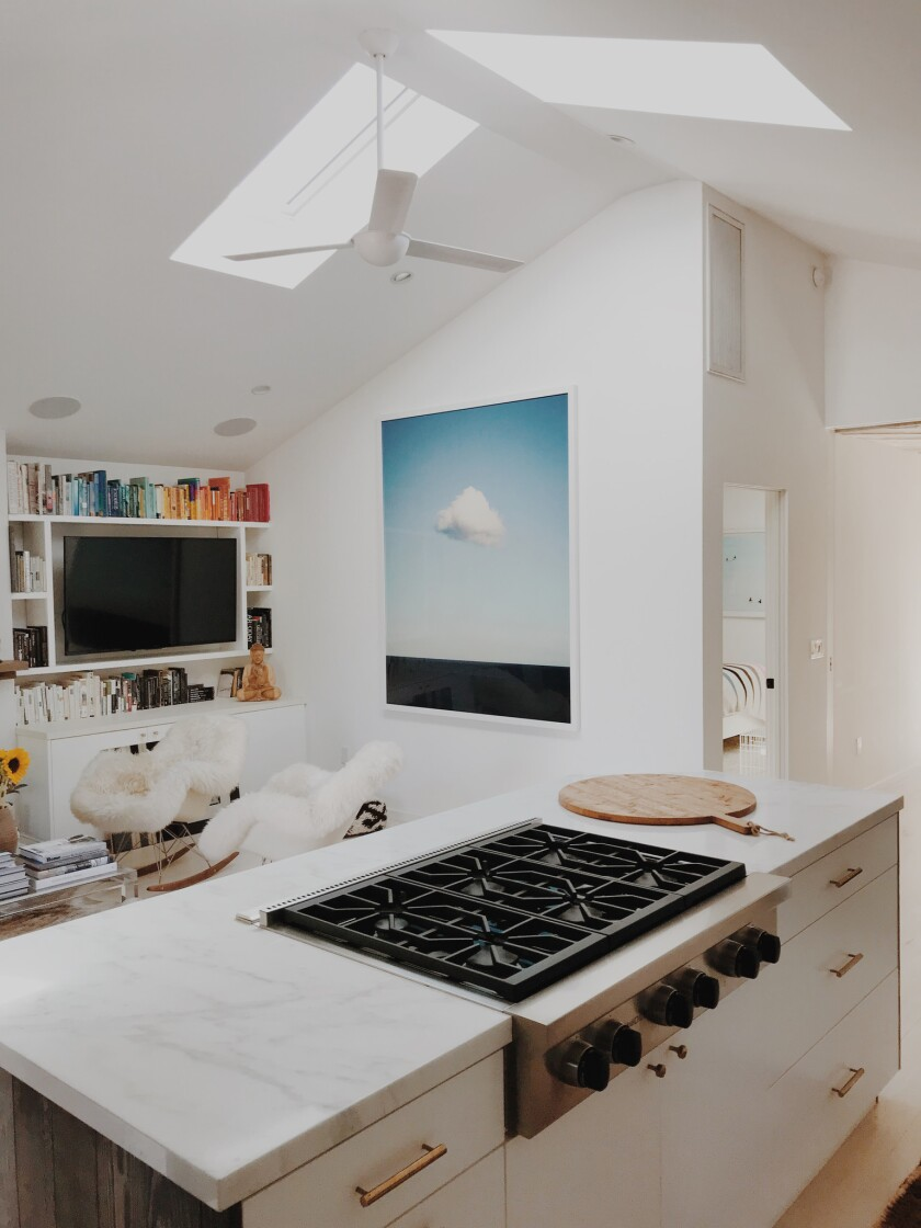 In a Mar Vista project by Mason St. Peter, a pair of skylights meet at the roof ridge. These operable Velux skylights cost about $1,800 to $3,000 each, depending on whether you're replacing an old skylight or putting in a brand new one.