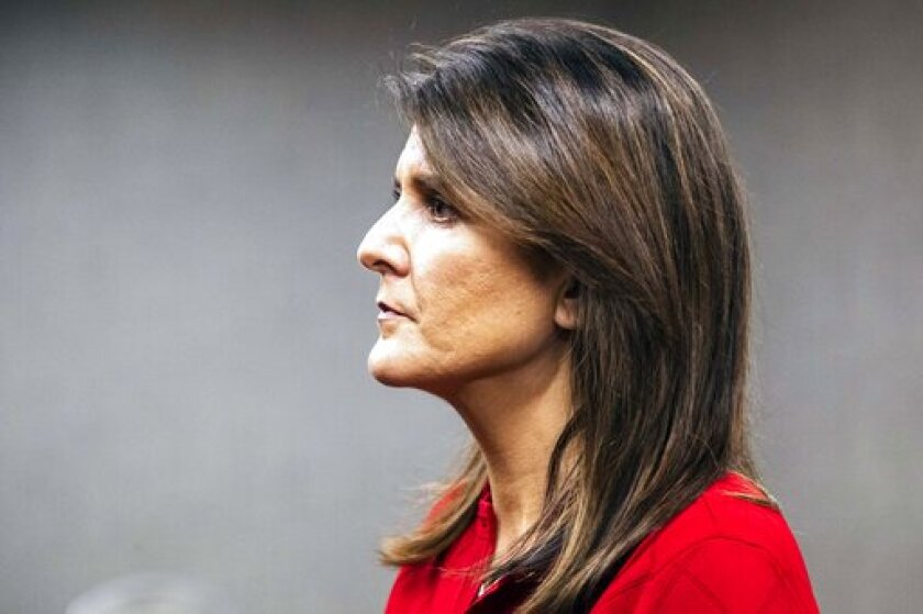 Former U.N. Ambassador Nikki Haley listens to a question while speaking to reporters after the Johnson County Republicans annual Reagan Dinner fundraiser, Wednesday, Oct. 21, 2020, at the Radisson Hotel & Conference Center in Coralville, Iowa.(Joseph Cress/Iowa City Press-Citizen via AP)