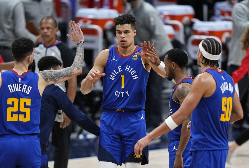 Denver Nuggets forward Michael Porter Jr. (1) is congratulated after hitting a 3-point basket against the Portland Trail Blazers in the second overtime during Game 5 of a first-round NBA basketball playoff series Tuesday, June 1, 2021, in Denver. (AP Photo/Jack Dempsey)