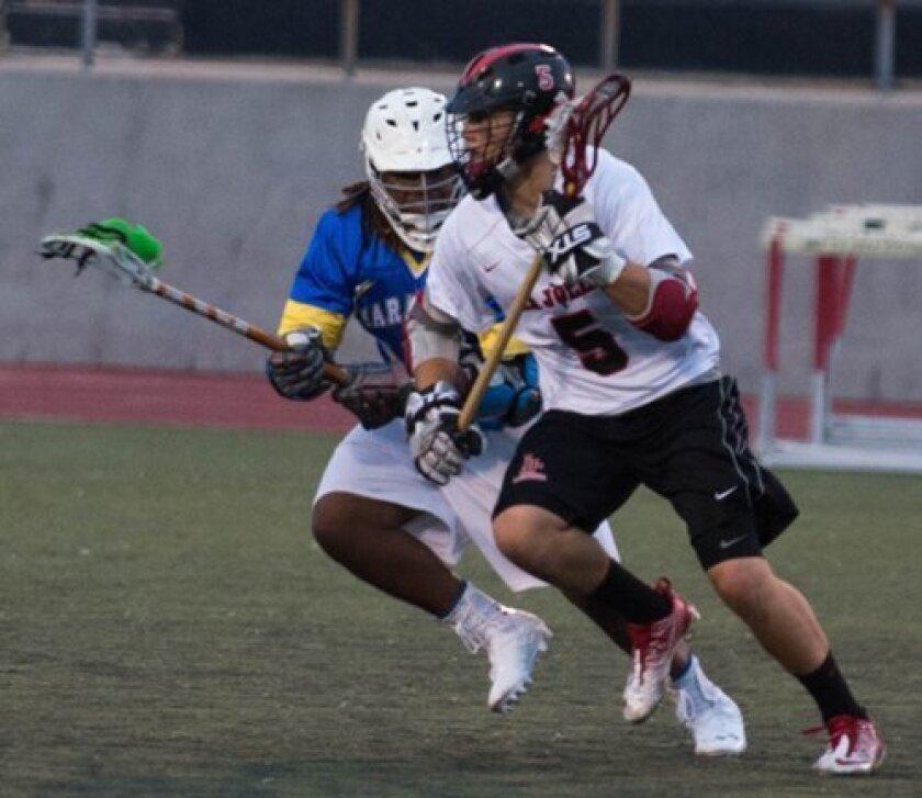 Brandon Richmond (5) of La Jolla High School moves on the attack against Mira Mesa. Ed Piper