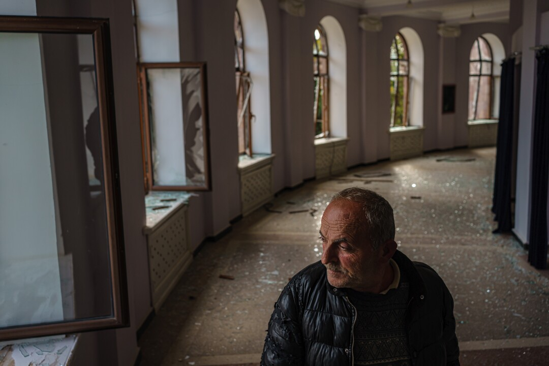 Leonard Hovanissian, 61, stands in the theater in Martuni, whose windows were blown out in a military strike.