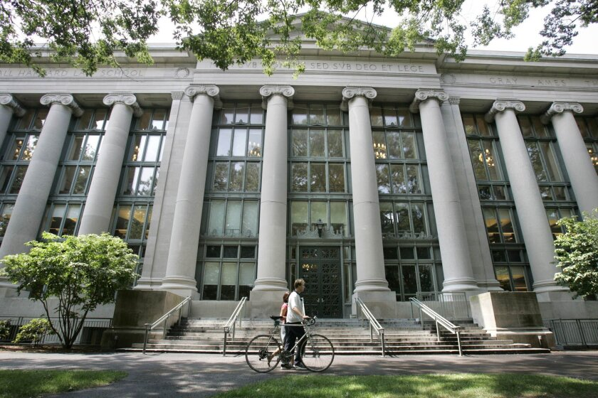 FILE - In this Aug. 1, 2005, file photo, a bicyclist walks by Harvard University's Langdell Hall, which includes Harvard Law School's library, in Cambridge, Mass. Following an October 2015 talk at Harvard Law School organized by students in the group Justice for Palestine, the international law fir