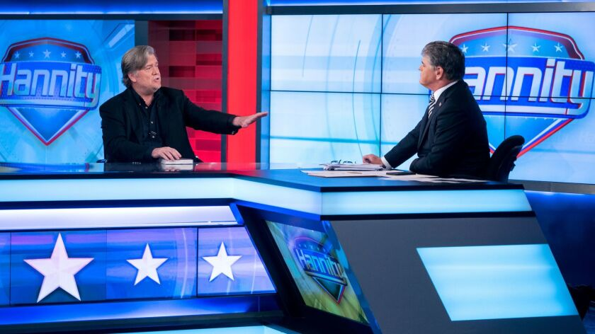 Sean Hannity interviews Former White House strategist Steve Bannon on the set of Fox News Channel's Hannity in New York on Oct. 9.