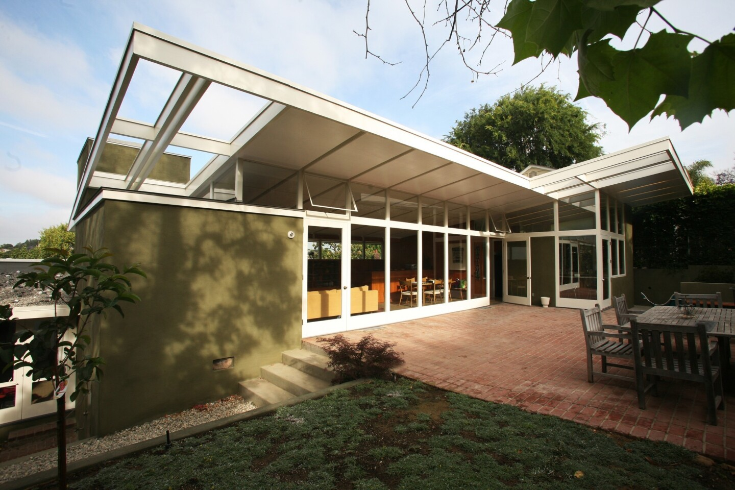 """Tony Unruh and Keith Sidley were South African-born architects with an affinity for midcentury master Gregory Ain. Unruh had bought Ain's old architecture office on Hyperion Avenue; Sidley was living with his family in a Silver Lake home designed and built in the early '40s by Ain. They shared a dream of renovating Sidley's house, but before the restoration could move beyond talk, Sidley died from a brain tumor, leaving his wife, Kathleen Nolen, to contemplate the task before her. """"I loved the house and wanted it to live forever,"""" Nolen said."""