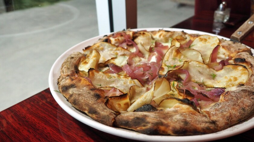 The Nana pizza from Flame Pizzeria in Reseda is topped with slivered potato ribbons, caramelized onion, dill and a drizzle of truffle oil.