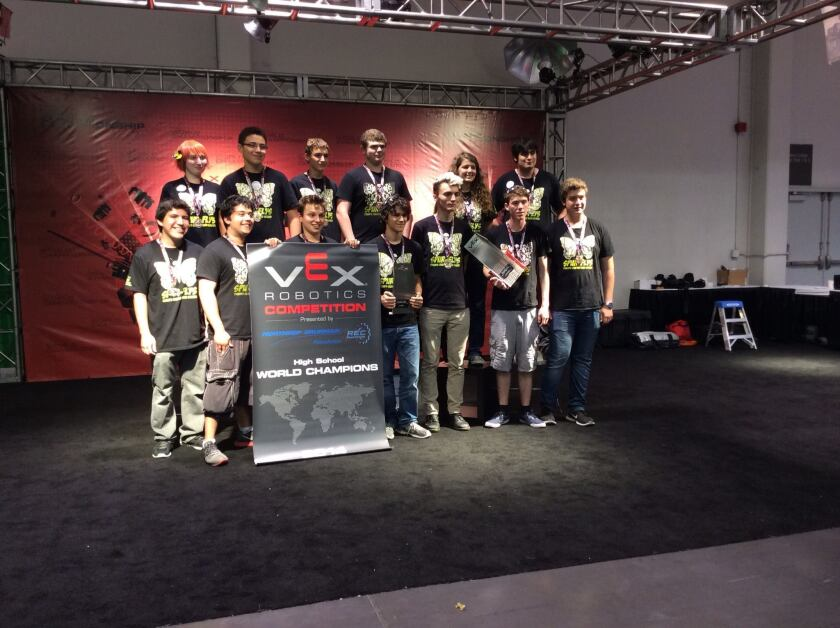 The SPUR-FLYS, from CHAMPS Charter High School of the Arts in Van Nuys, stand with their trophy after winning the world championship at the 2014 VEX Robotics Competition in Anaheim. Team members shared the win with a school in Ontario, Canada, and Auckland, New Zealand.