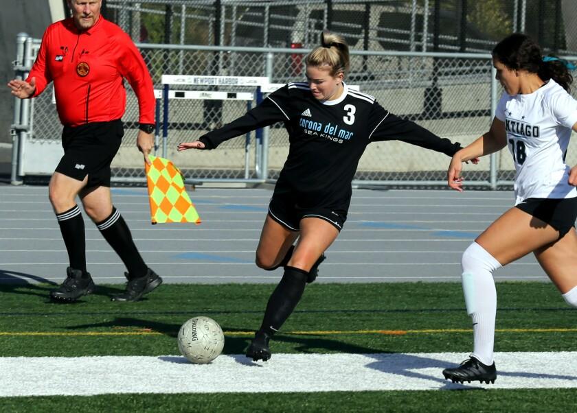 Corona del Mar senior Megan Chelf (3) is shown centering the ball against Corona Santiago.
