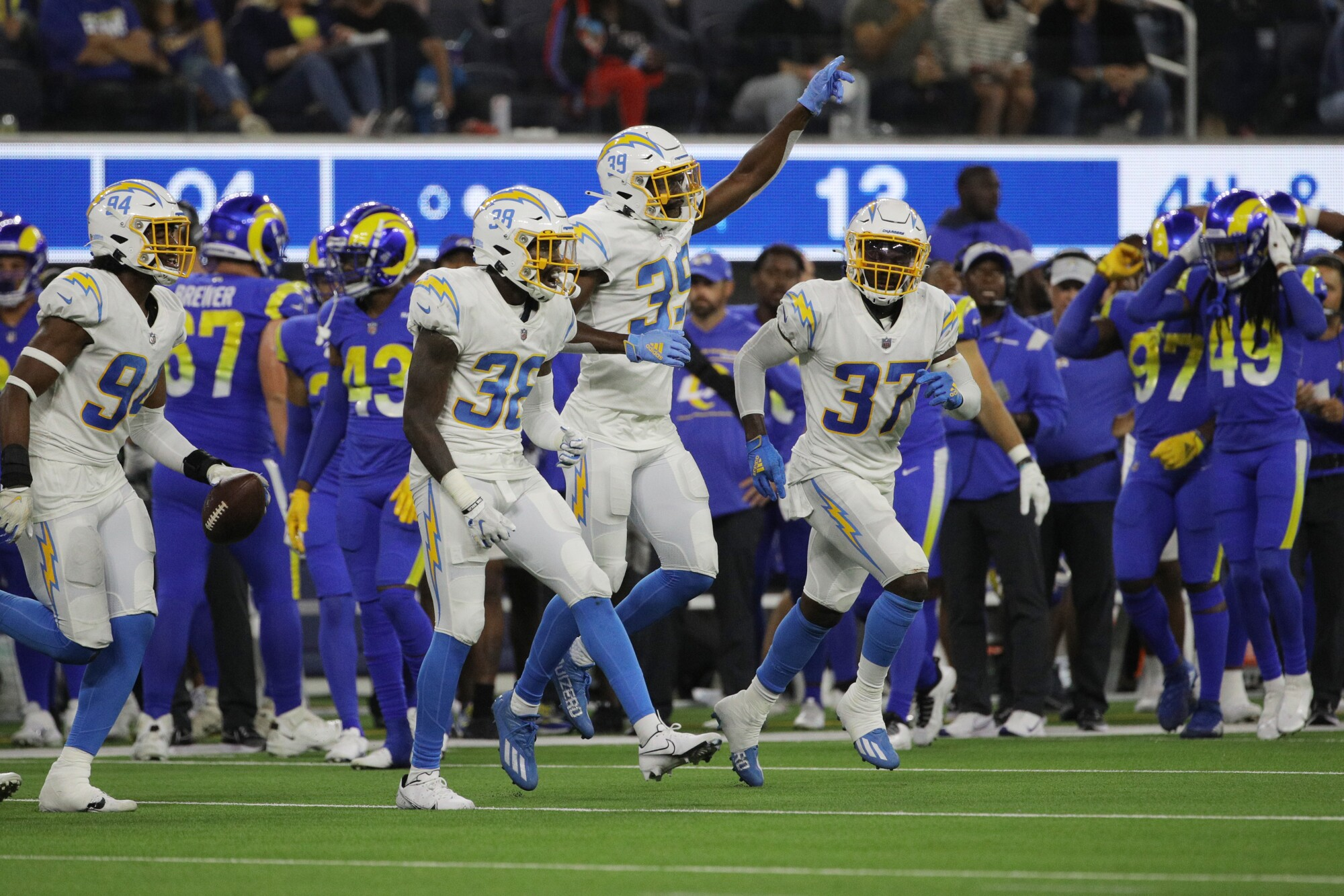 Chargers defensive back John Brannon celebrates with cornerback Donte Vaughn and defensive back Kemon Hall.