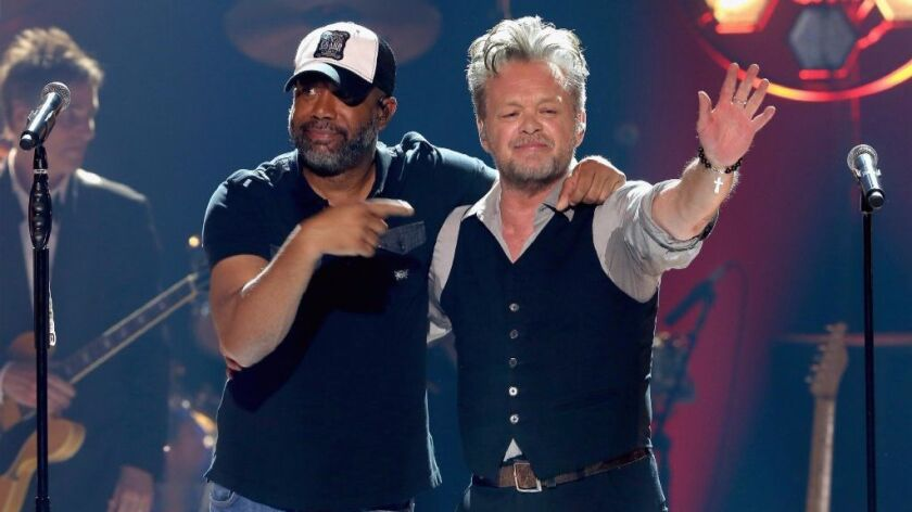 """Darius Rucker, left, and John Mellencamp performed together for a """"CMT Crossroads"""" special."""