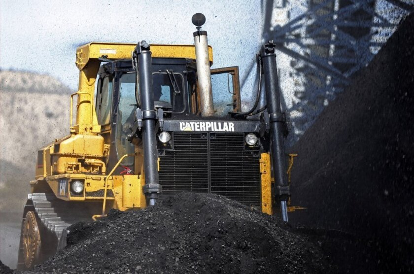 Ready to excavate a hole in the tax code: A Caterpillar earthmover at work at a Utah coal mine.