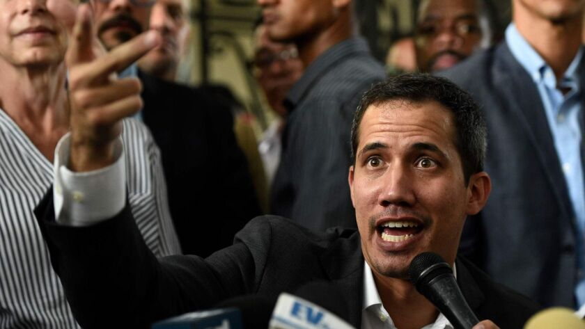 Venezuelan opposition leader and self-proclaimed acting President Juan Guaido speaks at a news conference in Caracas on Tuesday.