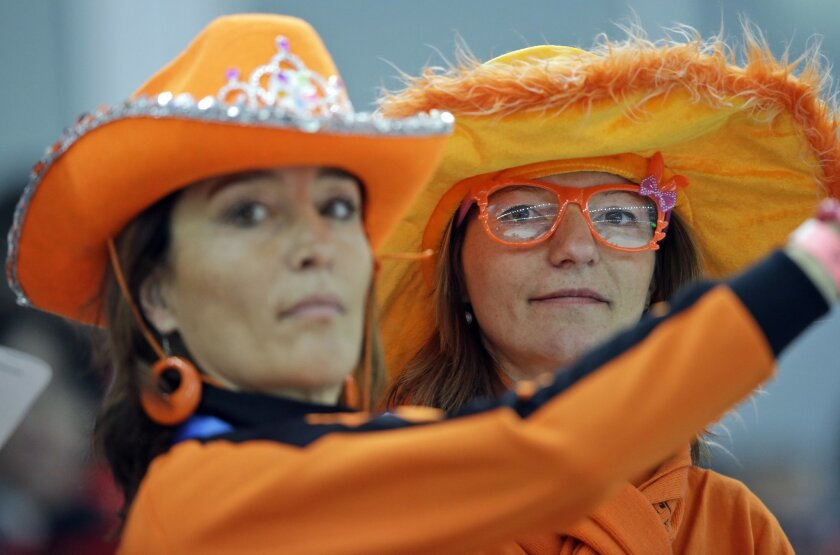 Dutch skating fans watch the men's 5,000-meter speedskating race at the Adler Arena Skating Center during the 2014 Winter Olympics, Saturday, Feb. 8, 2014, in Sochi, Russia. The Netherlands' won all gold, silver and bronze. (AP Photo/Patrick Semansky)