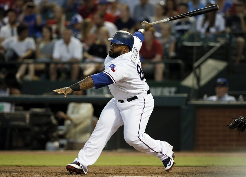 Texas Rangers' Prince Fielder follows through on a single off of New York Yankees' Ivan Nova in the fifth inning of a baseball game Monday, July 27, 2015, in Arlington, Texas. (AP Photo/Tony Gutierrez)