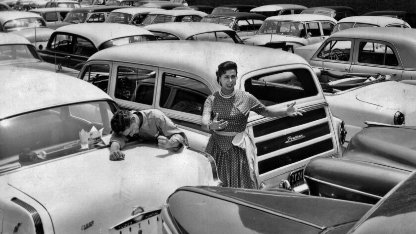 June 20, 1955: A woman pleads with a downtown L.A. parking lot attendant to get her car out.