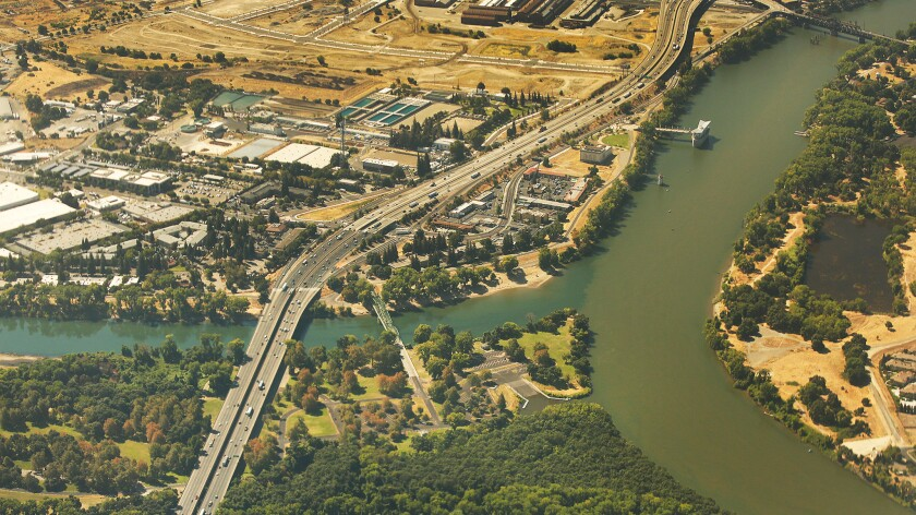 Shown is the confluence of the American River, left, and the Sacramento River, right, in Sacramento.