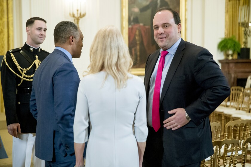 FILE - This April 1, 2019 file photo shows Boris Epshteyn, former special assistant to President Donald Trump, right, at the 2019 Prison Reform Summit and First Step Act Celebration in the East Room of the White House in Washington. The Sinclair group of local television stations said Wednesday, Dec. 11, it is dropping its commentary segments featuring Epshteyn in favor of a greater emphasis on local investigative journalism. (AP Photo/Andrew Harnik, File)