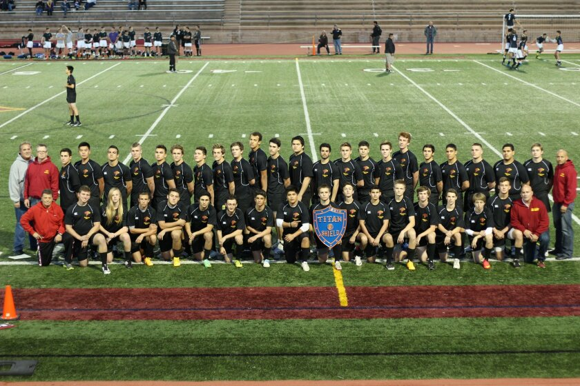 Rugby is enjoying its first season on the Torrey Pines High campus as a school sport. The team posed here before its first match, Dec. 19, 2014, a 27-12 victory over St. Augustine.