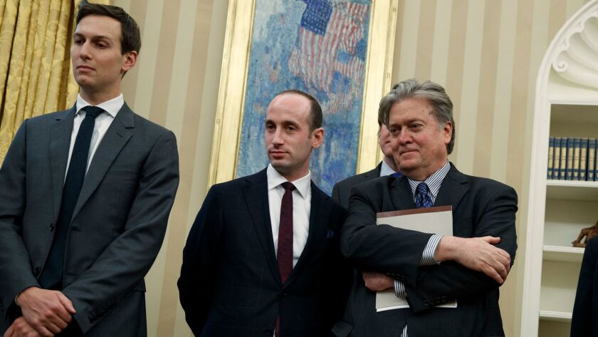 Stephen Miller, center, with Jared Kushner, left, and Stephen Bannon in the Oval Office.