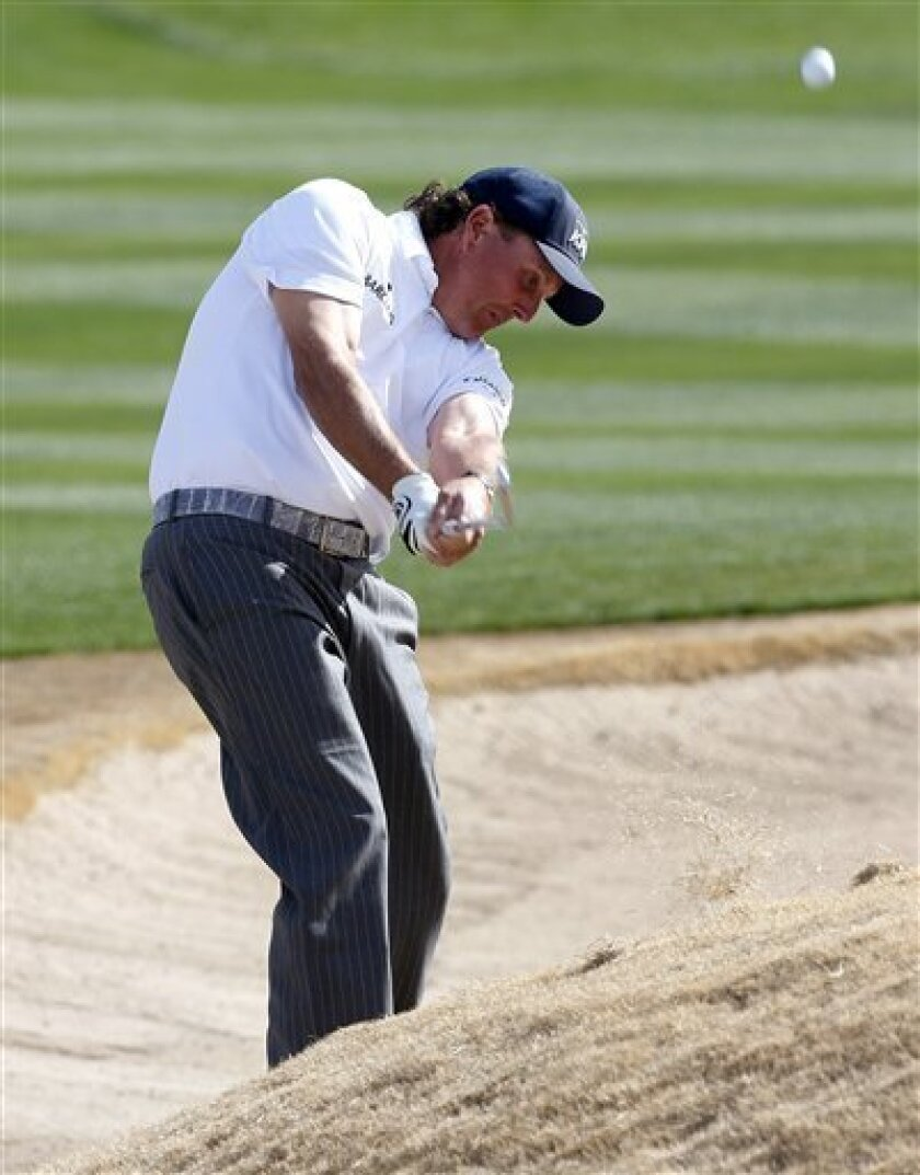 Phil Mickelson hits from a bunker on the third hole during the third round of the Waste Management Phoenix Open golf tournament, Saturday, Feb. 2, 2013, in Scottsdale, Ariz. (AP Photo/Matt York)