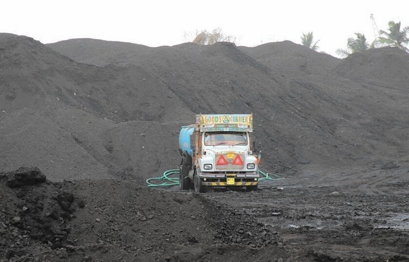 The Haji Bunder coal site in Mumbai, India. Critics say the mountains of coal, imported from Indonesia and Australia, are causing health and environmental problems.