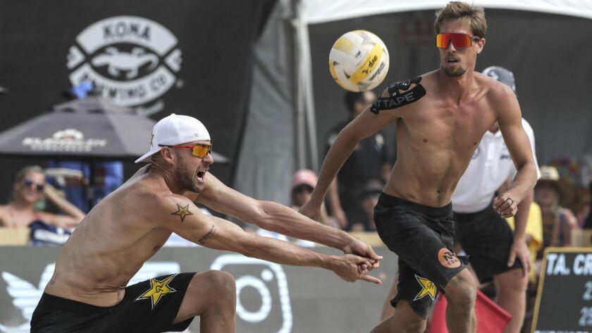 HUNTINGTON BEACH, CA, SUNDAY, MAY 5, 2019 - Jake Gibb digs the ball as teammate Taylor Crabb moves t