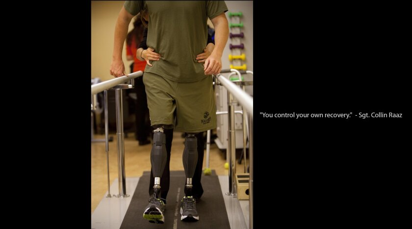 Marine Sgt. Collin Raaz takes his first steps in his new prosthetic legs at Naval Medical Center San Diego last October. Raaz, who lost his legs while serving in Afghanistan, is the type of patient Invictus San Diego would serve. Nelvin C. Cepeda • U-T