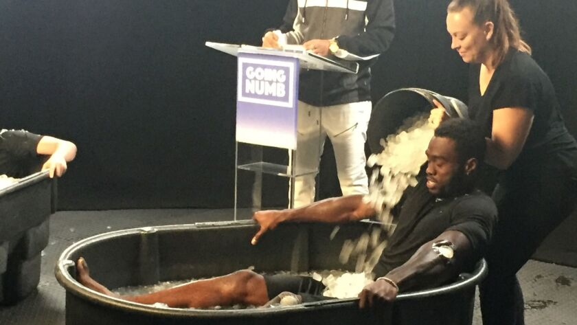 "Rams receiver Brandin Cooks receives icy treatment during taping of ""Going Numb."" Gary Klein / L"