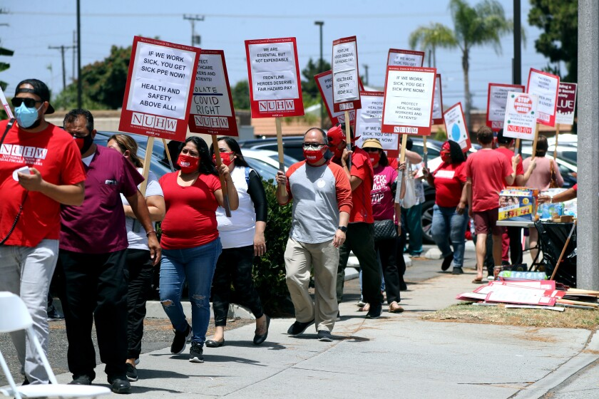 Kindred Hospital employees protest outside the main entrance.