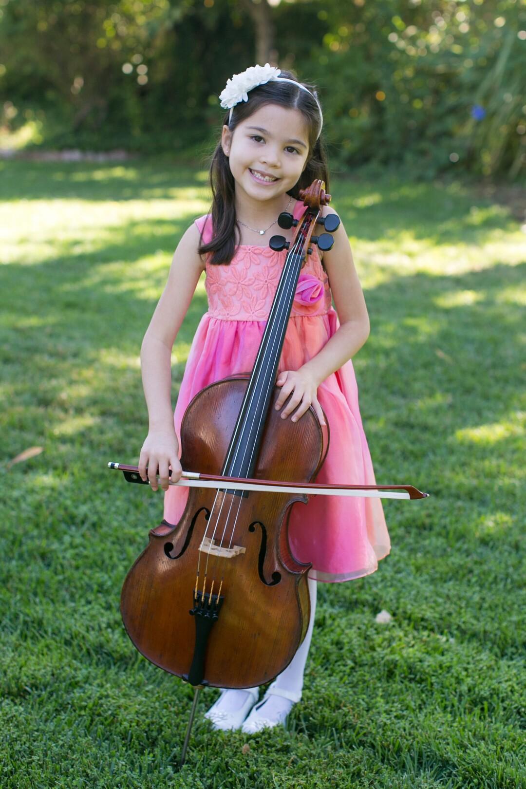 Starla Breshears at age 6 with the Bernardel cello.