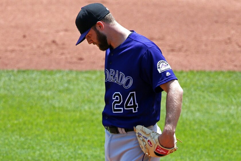 Colorado Rockies starting pitcher Jordan Lyles stands on the mound as he waits for Walt Weiss to pull him from the baseball game in the third inning against the Pittsburgh Pirates in Pittsburgh, Monday, May 23, 2016. (AP Photo/Gene J. Puskar)