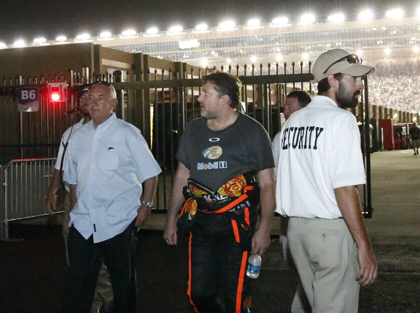 Sprint Cup Series driver Tony Stewart (14) walks to his motorhome after hitting the wall and retiring from a NASCAR Sprint Cup auto race at Atlanta Motor Speedway Sunday, Aug. 31, 2014, in Hampton, Ga.. (AP Photo/Brynn Anderson)