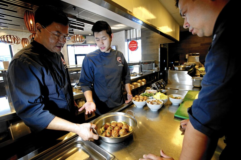 Panda Express Executive Chef Andy Kao, left, the inventor of orange chicken, tries meatball recipes with product manager Adrian Lok and Jimmy Wang, director of culinary innovation, at the company's Innovation Kitchen in Pasadena.