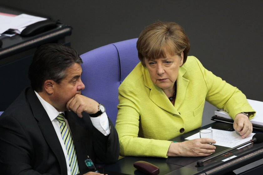 German Chancellor Angela Merkel, right, talks to Vice Chancellor and Economy Minister Sigmar Gabriel during a debate about the European Union and an Eastern Partnership with former Soviet Republics at the German parliament Bundestag, in Berlin, Germany, Thursday, May 21, 2015. (AP Photo/Markus Schreiber)