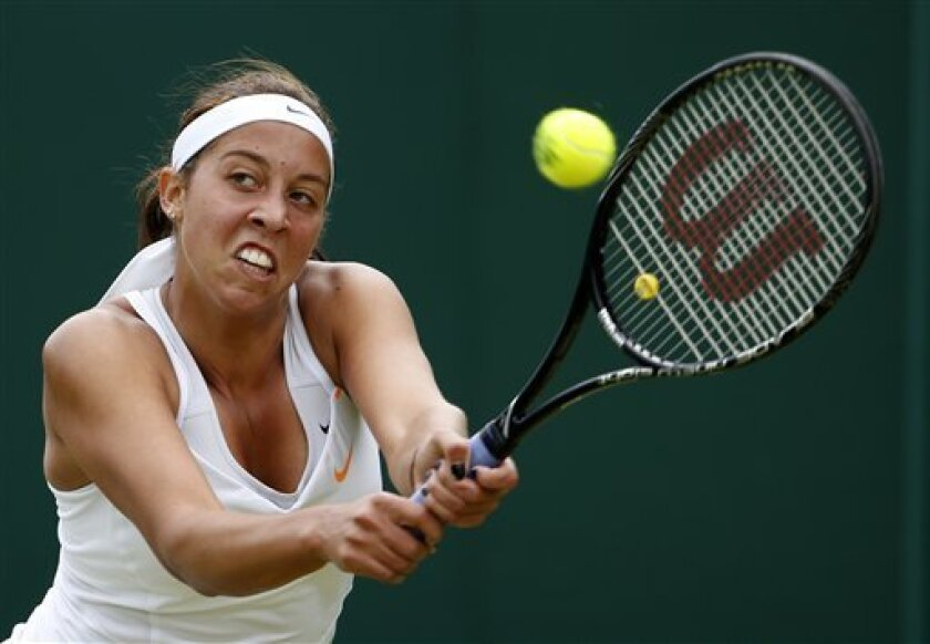 Madison Keys of the United States returns to Mona Barthel of Germany during their Women's second round singles match at the All England Lawn Tennis Championships in Wimbledon, London, Thursday, June 27, 2013. (AP Photo/Sang Tan)