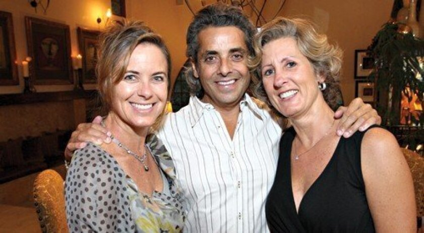 Hosts Erin and Tony Smith with Juliette Widholm