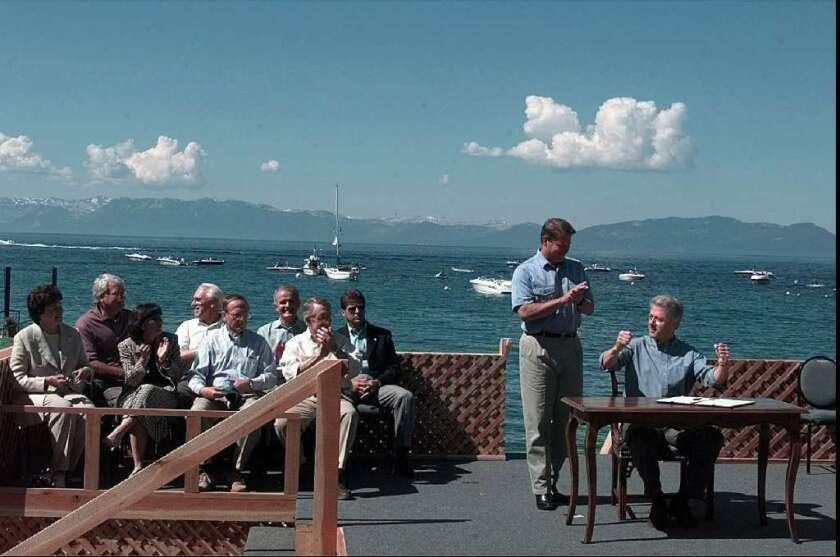 At the first Lake Tahoe summit in 1997, President Clinton raises clinched fists in celebration after signing an executive order on the preservation of the lake in a ceremony at Incline Village, Nev. From left in the front row are Sens. Dianne Feinstein and Barbara Boxer of California, and former Sen. Richard Bryan and Senate Majority Leader Harry Reid of Nevada. Vice President Al Gore applauds at Clinton's side. Gore and Feinstein will join Gov. Jerry Brown at the 17th annual Lake Tahoe summit on Monday.