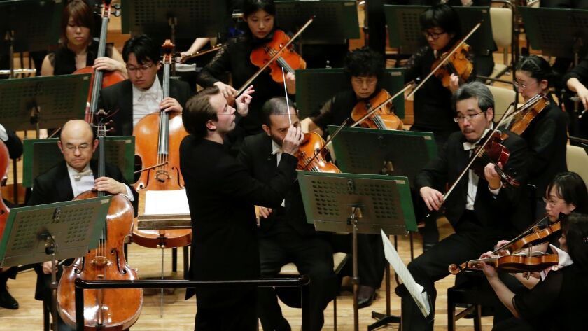 Finland's Pietari Inkinen conducts the Japan Philharmonic Orchestra during their concert at Suntory Hall in Tokyo.