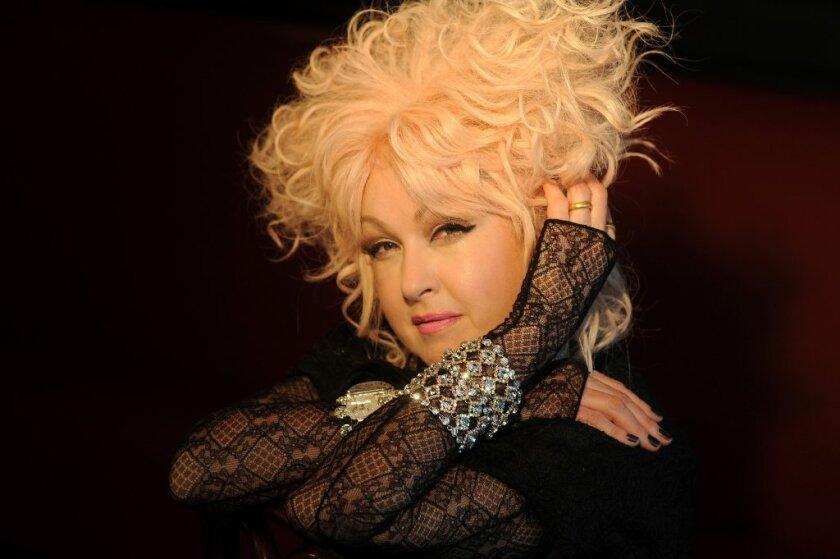 Cyndi Lauper is hosting the Grammy pre-telecast ceremony on Sunday.