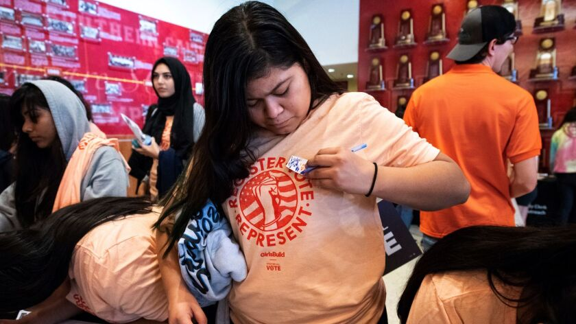 LOS ANGELES, CA - SEPTEMBER 28, 2018: Miguel Contreras Learning Complex student Kate Cruz, 16, puts